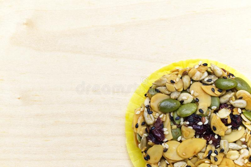 Mix organic whole grains energy cookie on wooden background. royalty free stock photography