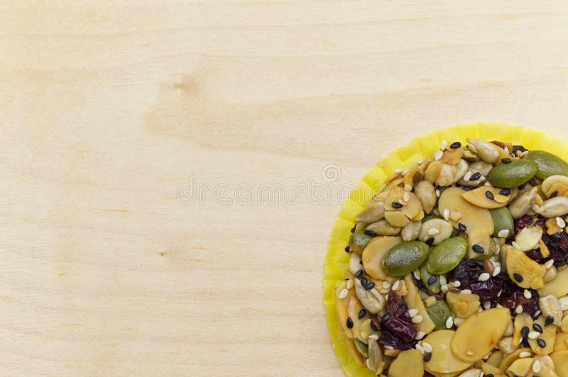 Mix organic whole grains energy cookie on wooden background. royalty free stock photos
