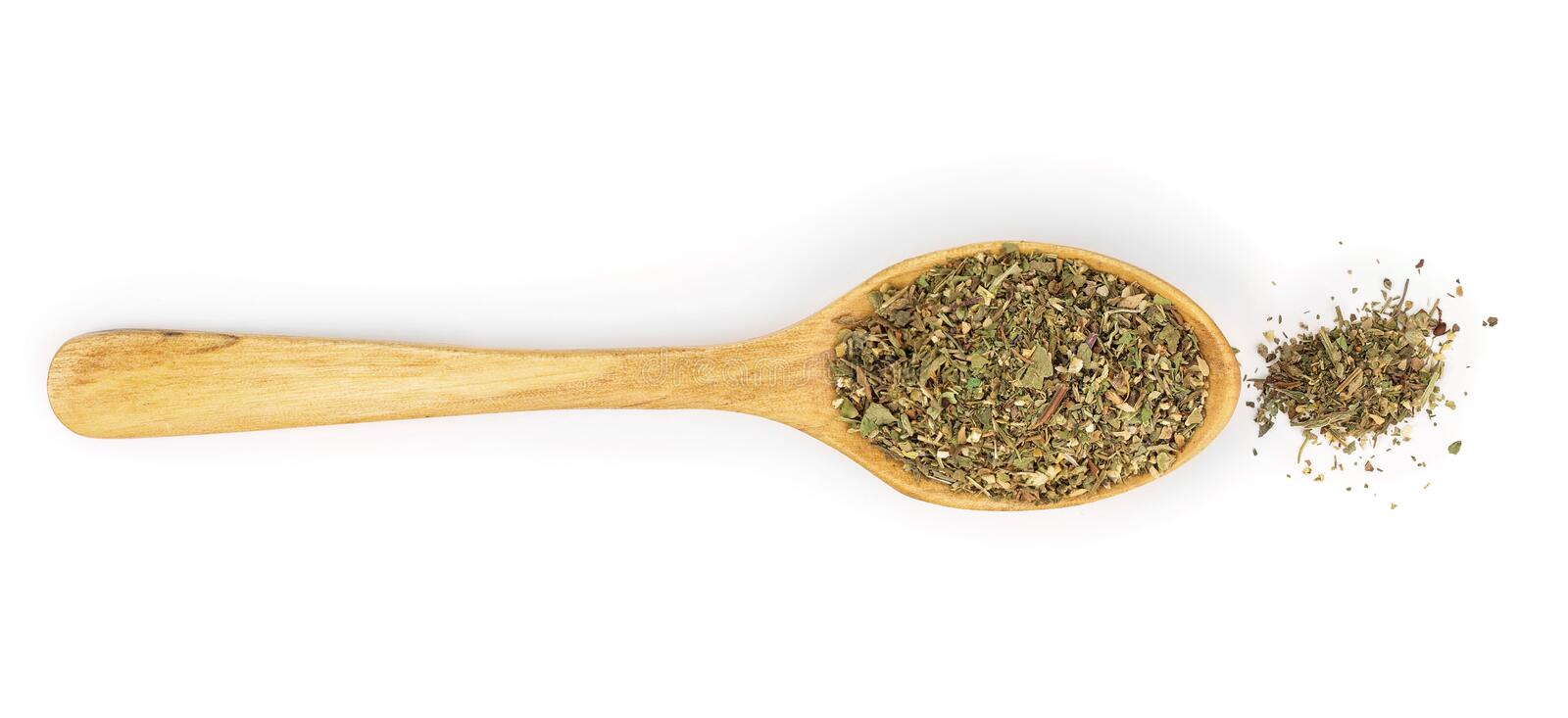 Mix Provencal herbs in wooden spoon isolated on white background. Top view.  stock photos