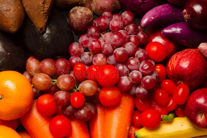 Mix purple and red vegetable and fruit royalty free stock images