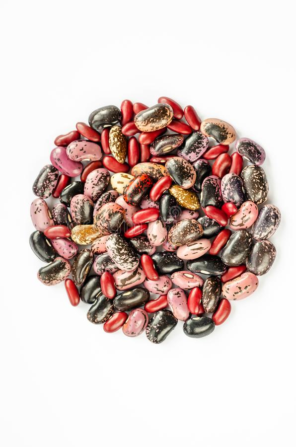 Mix of raw beans on white background. Top view of assortment of multi colored dried kidney beans stock images