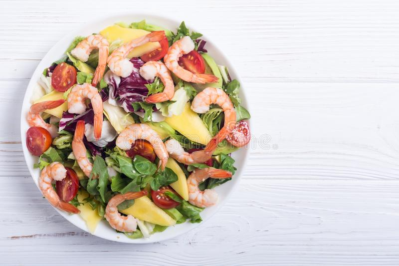 Mix of salad with shrimps avocado and cherry tomatoes . Healthy food background royalty free stock photos
