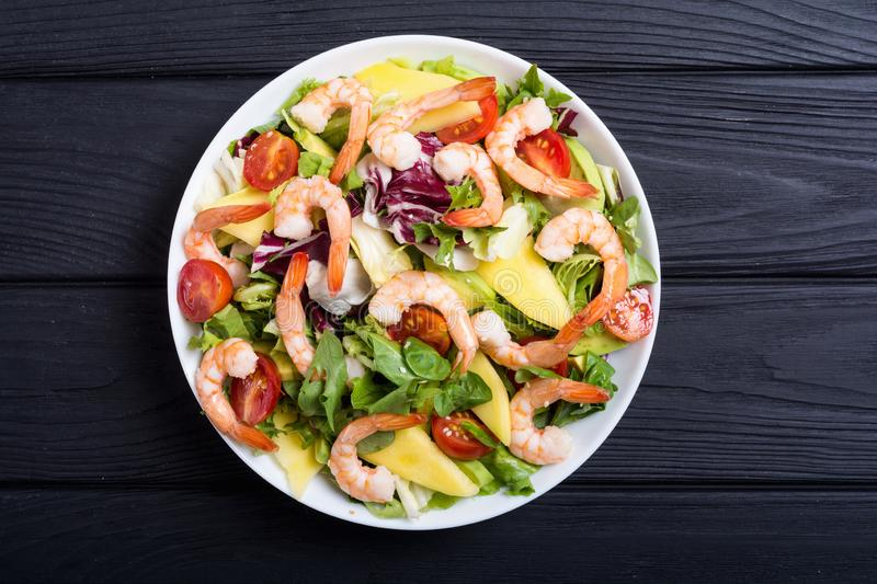 Mix of salad with shrimps avocado and cherry tomatoes . Healthy food background stock images