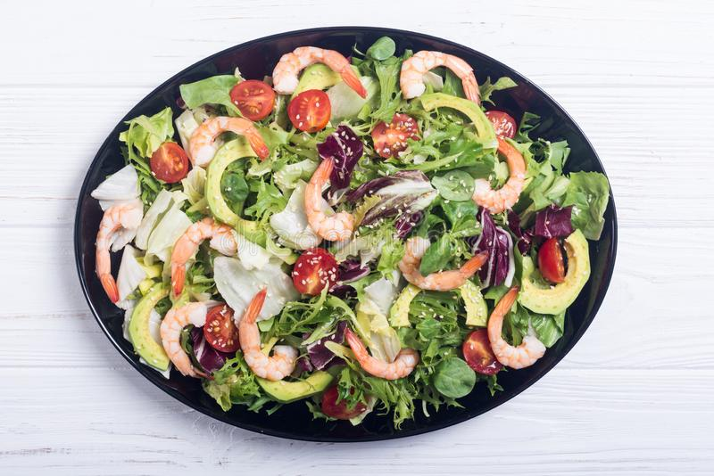 Mix of salad with shrimps avocado and cherry tomatoes . Healthy food background stock photos