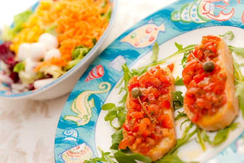Mix Salad with tomato bruschetta stock photos