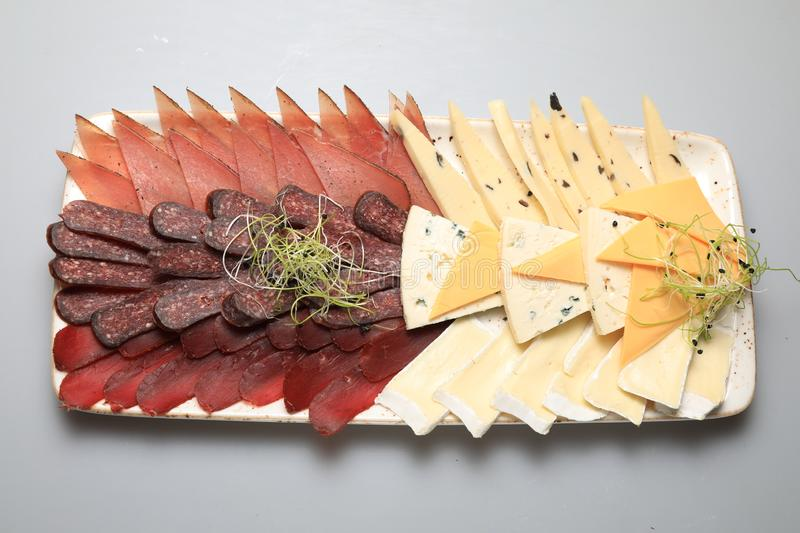 A mix of salami, cheese, ham on a plateau stock photos