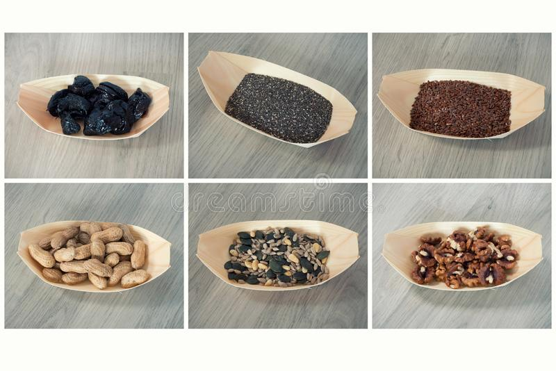 Mix of seeds. Dried plums, chia seeds, flaxseed, peanuts, sunflower seeds and pumpkin seeds, greek nuts royalty free stock photo
