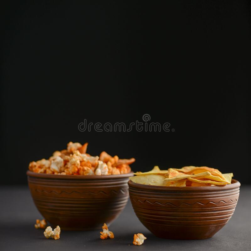 Mix Of Snacks In Bowls Salty Butter Popcorn And Tortilla Chips In Ceramic Bowl Over Dark Black Background Stock Photo Image Of Collection Heap 173684800