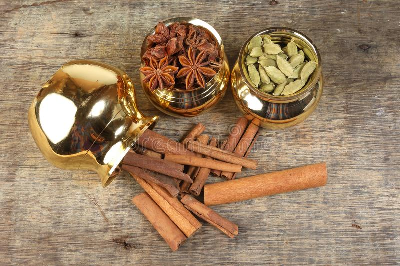 Mix spice in golden metal pot on rustic wood royalty free stock photos