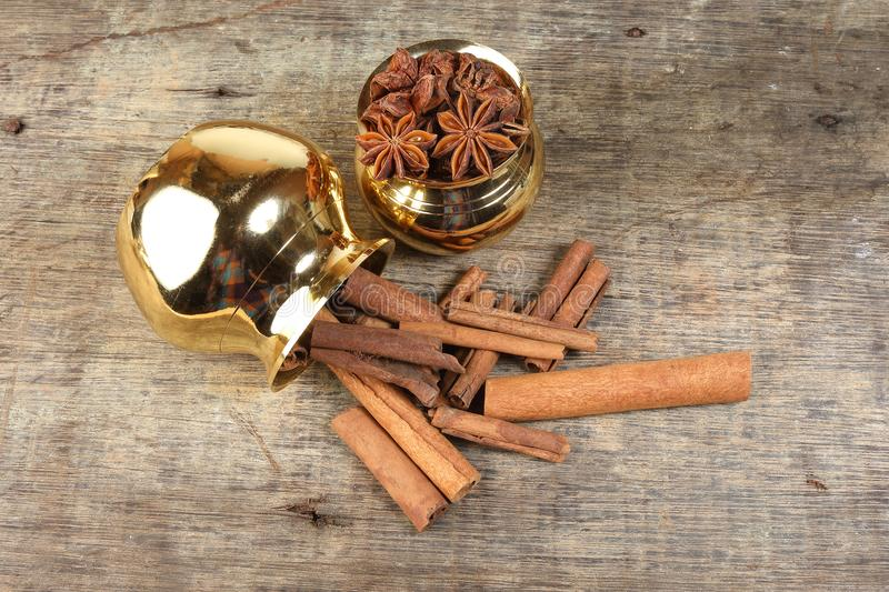 Mix spice in golden metal pot on rustic wood royalty free stock photo