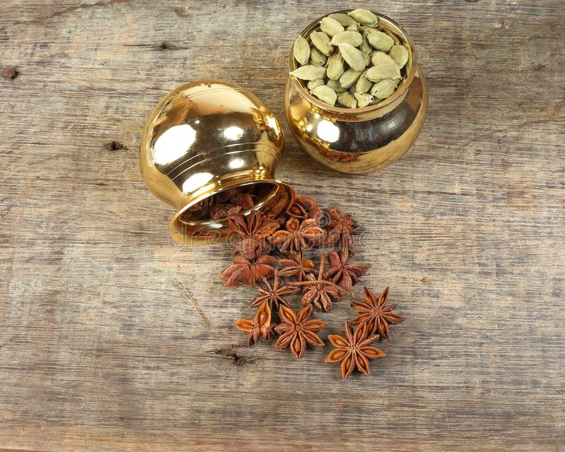 Mix spice in golden metal pot on rustic wood stock images