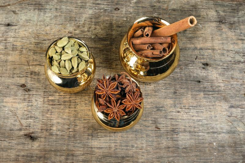 Mix spice in golden metal pot on rustic wood stock photos