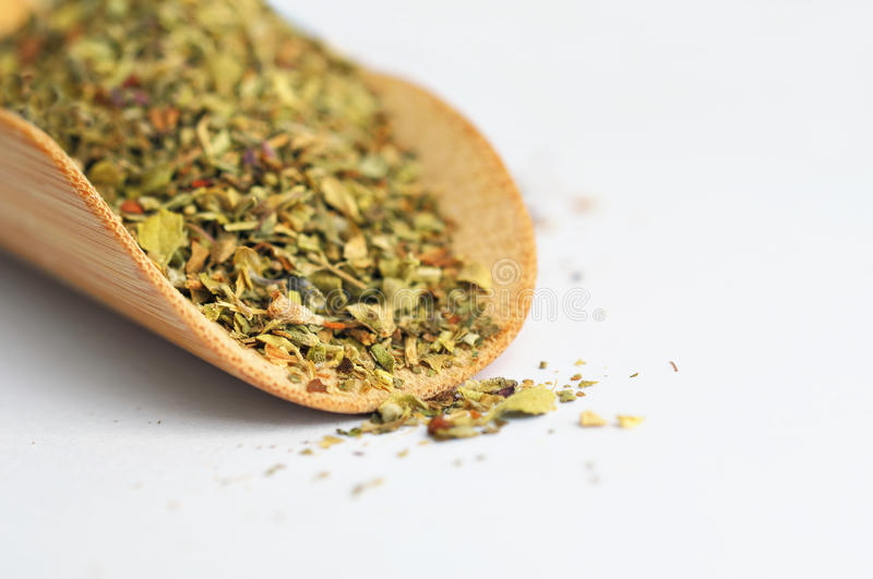 Mix of spice herbs in wooden spoon stock image
