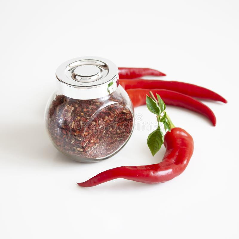 Mix of spices in a glass jar. Red chili peppers. Organic food. Cooking background. Mix of spices in a glass jar. Red chili peppers. Cooking. The ingredients stock photography