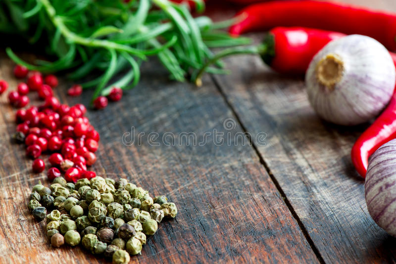 Mix of spices herbs and vegetables on table close up stock image