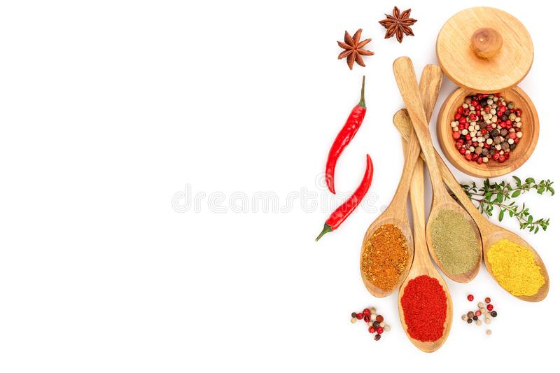 Mix of spices in wooden spoon isolated on a white background with copy space for your text. Top view. Flat lay. Set or royalty free illustration