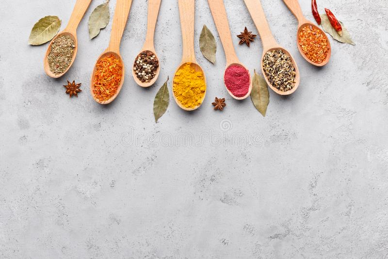 Mix of spices in wooden spoons, top view stock photography