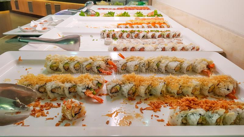 Mix of sushi buffet and rolls, Japanese traditional food, Dishes from raw fish in restaurant stock photos