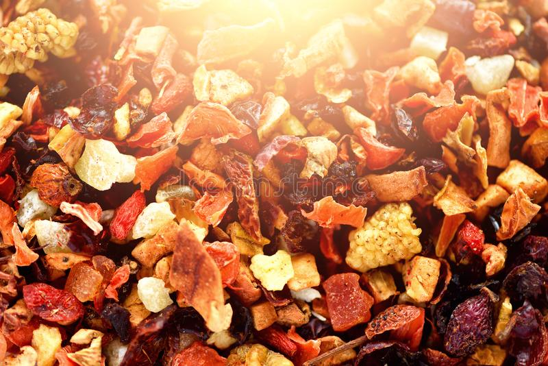 Mix tea karkade with dried fruits and flowers. Fruit tea background and texture. Top view. Food background. Organic stock image