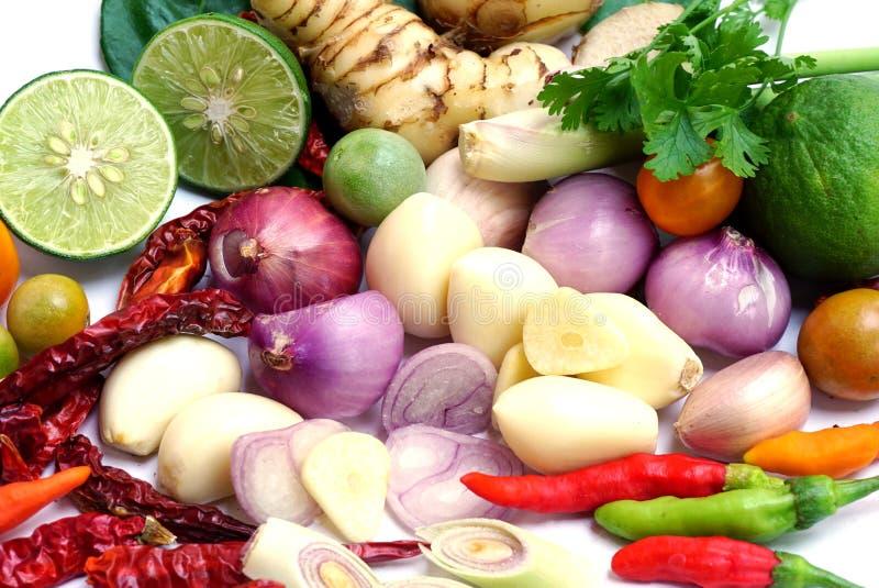 Mix of vegetable ingredients for Thai food Tom Yum, garlic, onion,pepper,galangal, kaffir lime leaves,lemon,lemon grass,tomato royalty free stock photos