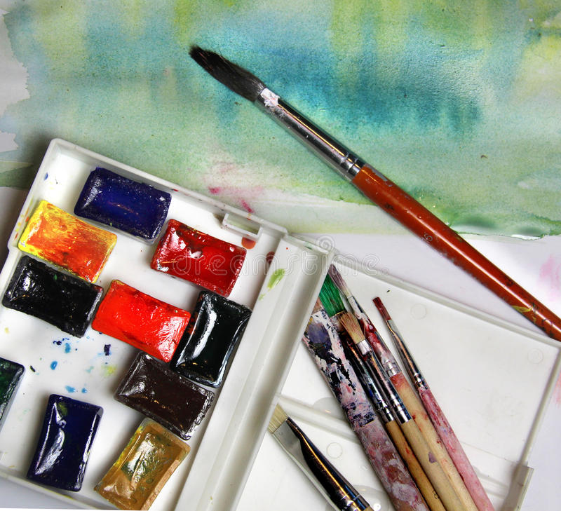 Mix of watercolors and paintbrushes. Mix of multicolored watercolors and paintbrushes royalty free stock photography