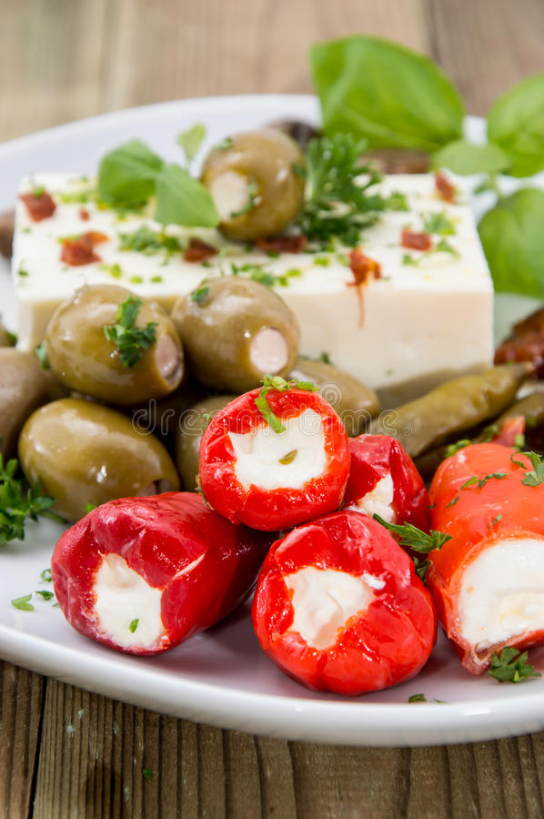 Mixed Antipasto on a plate. Against wood stock photography
