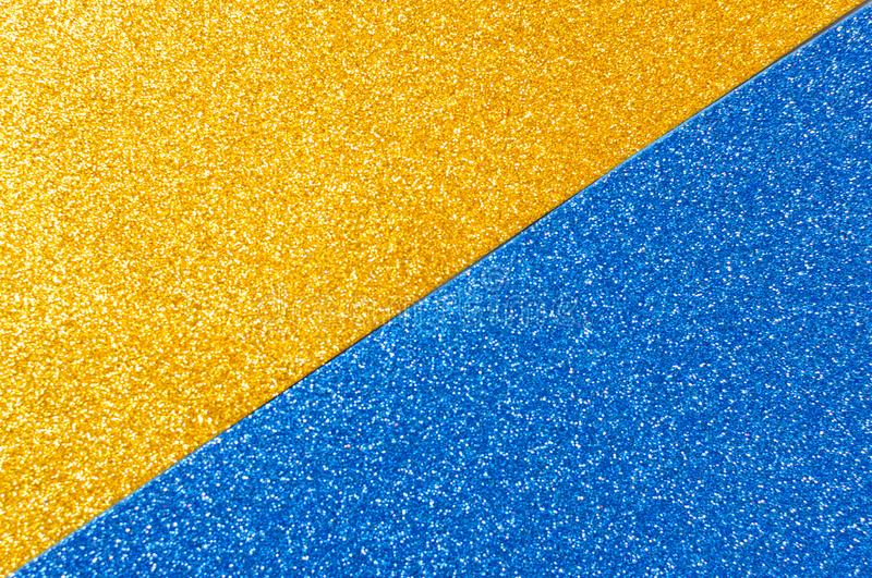 Mixed background glitter texture gold and blue, abstract background isolated. Mixed glitter texture gold and blue abstract background isolated royalty free stock photography