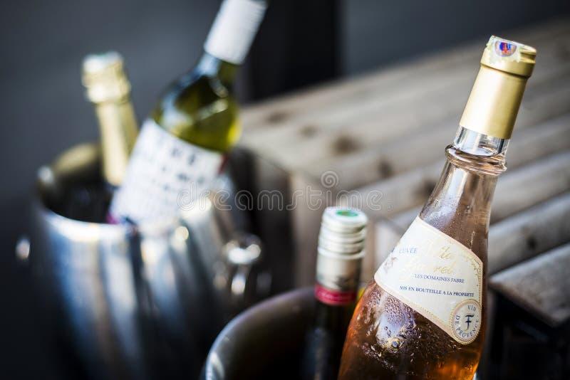 Mixed bottles of gourmet wine in ice chiller bucket stock photos