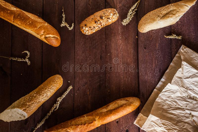Mixed breads background on wooden table, top view for your text. stock photography