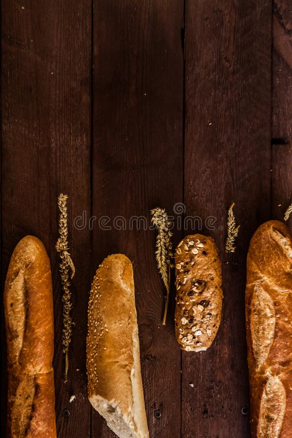 Mixed breads background on wooden table, top view for your text. stock image
