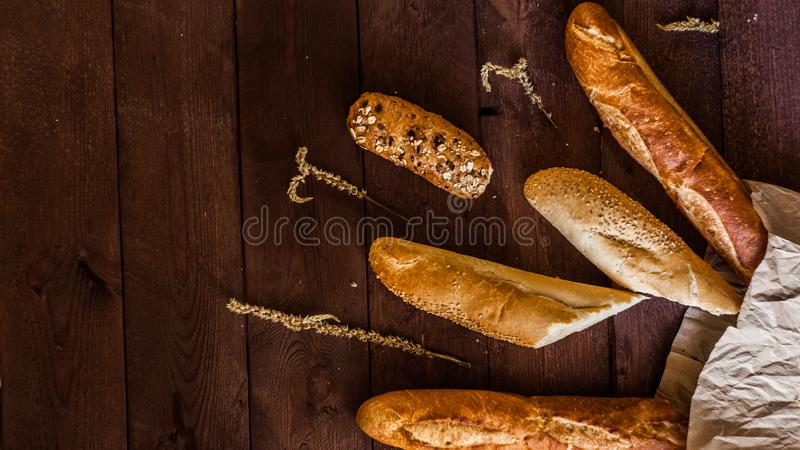 Mixed breads background on wooden table, top view for your text. stock photos
