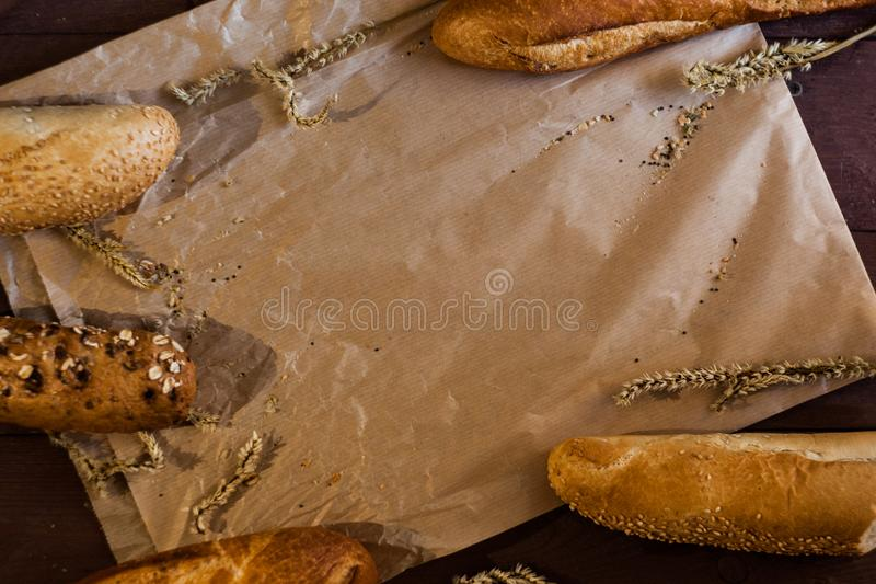 Mixed breads background on wooden table, top view for your text. royalty free stock photography
