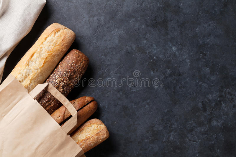 Mixed breads on stone table royalty free stock photography