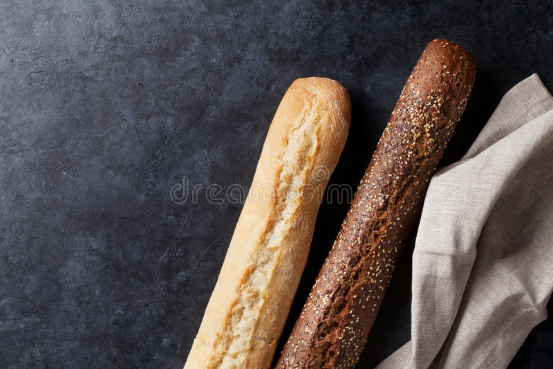 Mixed breads on stone table royalty free stock images