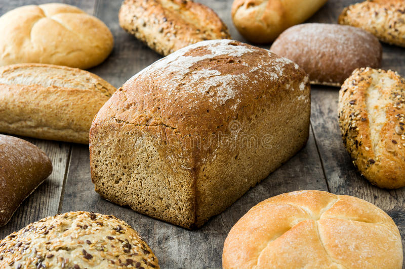Mixed breads on wooden table royalty free stock photography