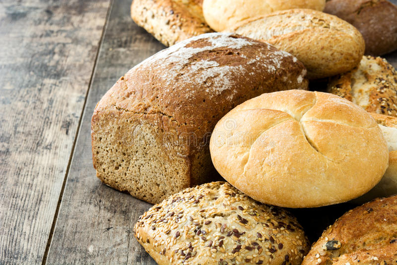 Mixed breads on wooden table royalty free stock photo