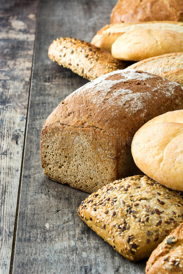 Mixed breads on wooden table stock photography