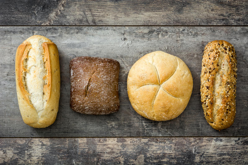 Mixed breads on wooden table. royalty free stock photo