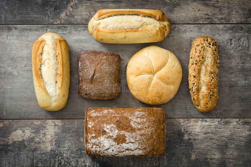 Mixed breads on wooden table. stock images