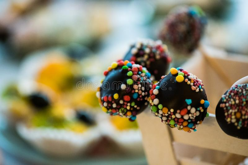 Mixed colored delicious sweets. Colored delicious sweets with chocolate royalty free stock photo