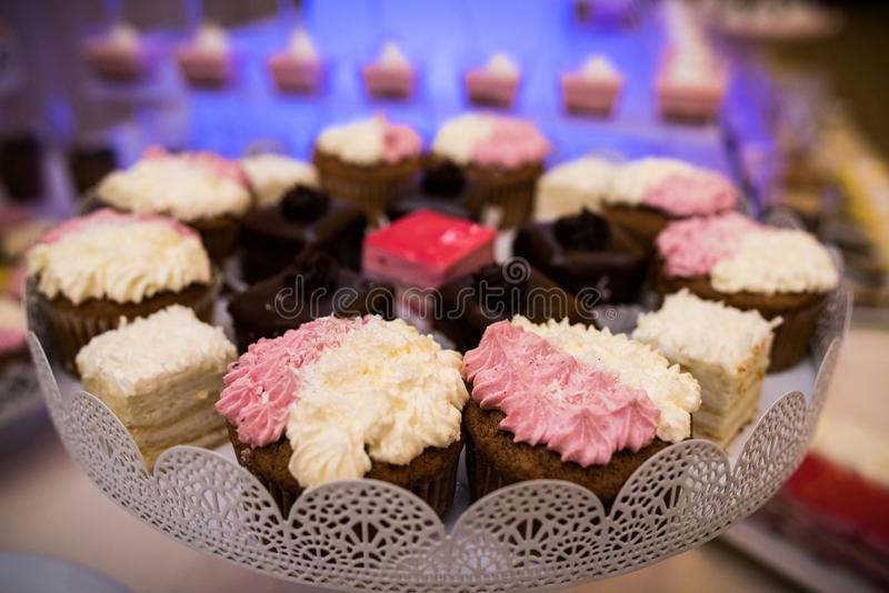 Mixed colored delicious sweets. Colored delicious sweets with whipped cream and biscuits royalty free stock photos