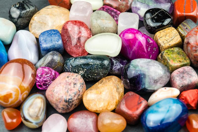 Mixed colorful jewels. A mix of colorful bright shining jewels stock photos