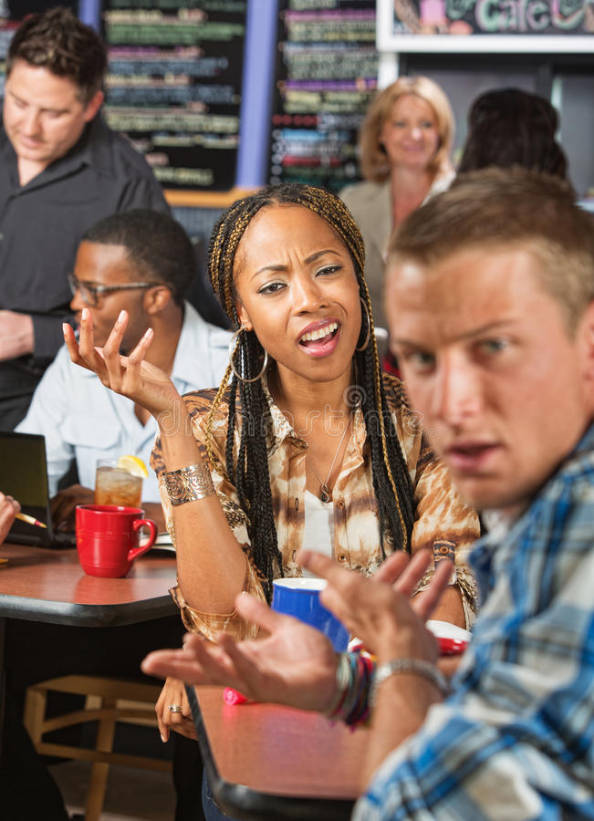 Mixed Couple Arguing. Mixed Black and white couple arguing in a cafe royalty free stock photos