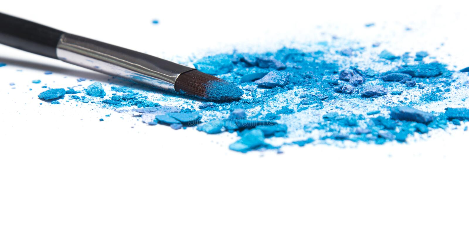 Mixed crushed compact blue eyeshadow different shades royalty free stock photography