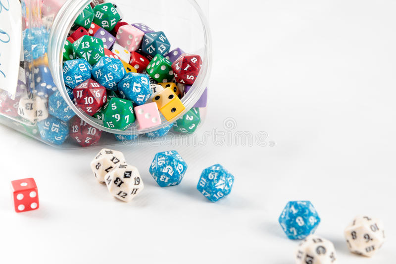 Mixed dice in a jar royalty free stock photography