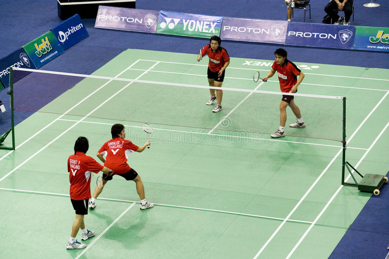 Mixed Doubles Badminton. Image of the mixed doubles pair of Sudket Prapakamol and Saralee Thoungthongkam of Thailand versus Wijaya Rendra and Meiliana Jauhari of royalty free stock image
