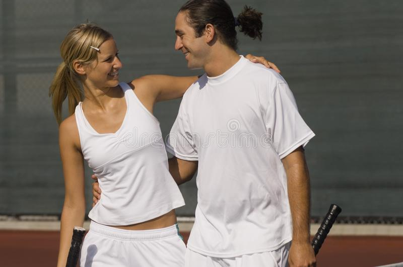 Mixed Doubles Partners. Standing on Court, arms around stock photos