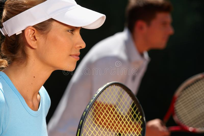 Mixed doubles tennis game stock image