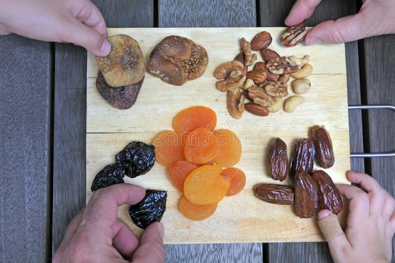 Mixed Dried Fruit on the Jewish holiday of Tu Bishvat. Mixed dried fruit on a wooden board served on the Jewish holiday of Tu Bishvat stock photos