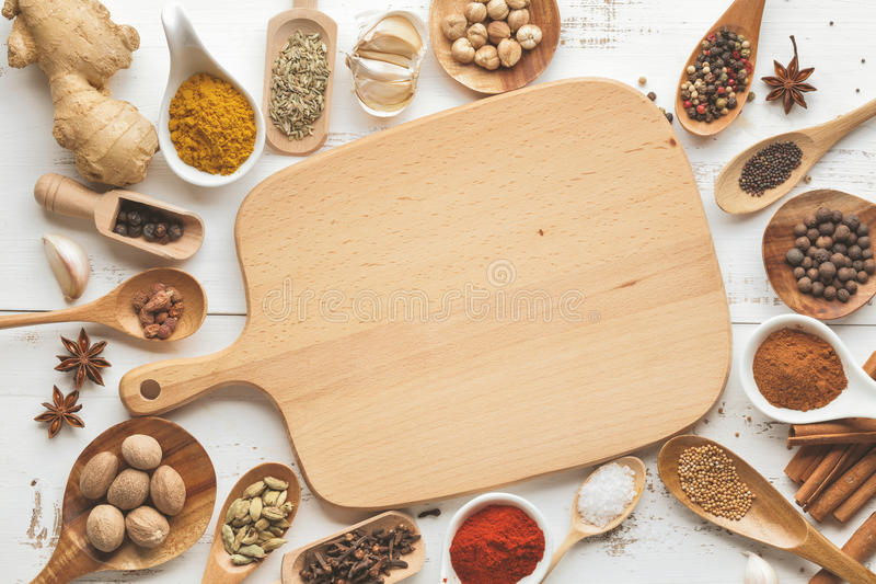 Mixed dry spices in wooden spoons stock image